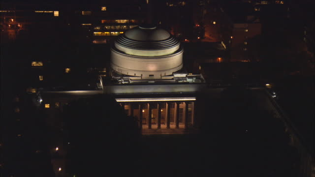 aerial ws illuminated dome of maclaurin building at massachusetts institute of technology campus / cambridge, massachusetts, usa - massachusetts stock videos & royalty-free footage