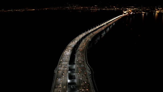 aerial illuminated new oakland bay bridge san francisco - カリフォルニア州 サンフランシスコ点の映像素材/bロール