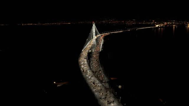 aerial illuminated new oakland bay bridge san francisco - oakland california stock videos & royalty-free footage