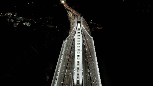 aerial illuminated new oakland bay bridge san francisco - oakland california stock videos & royalty-free footage