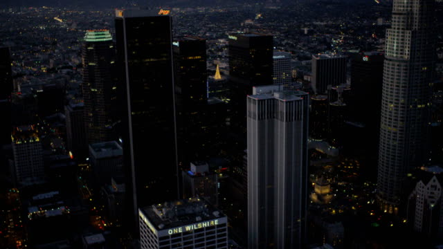 aerial illuminated night view downtown skyscrapers los angeles - block form stock-videos und b-roll-filmmaterial
