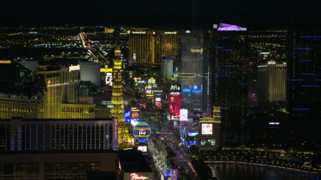 aerial illuminated night view eiffel tower las vegas - the strip las vegas stock videos and b-roll footage