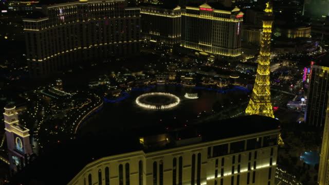 aerial illuminated night view las vegas bellagio fountains - caesars palace las vegas stock videos and b-roll footage