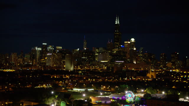 aerial illuminated night view of city of chicago - illinois stock videos & royalty-free footage