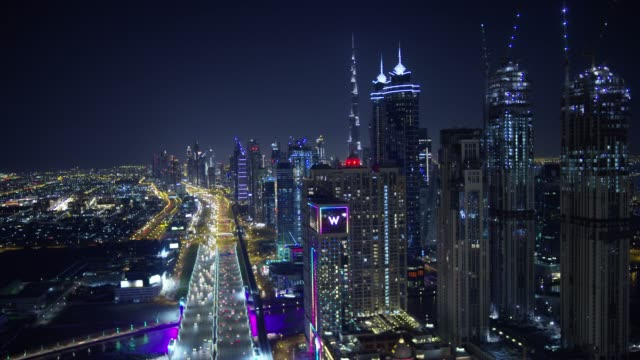 aerial illuminated night view sheikh zayed road dubai - skyscraper stock videos & royalty-free footage