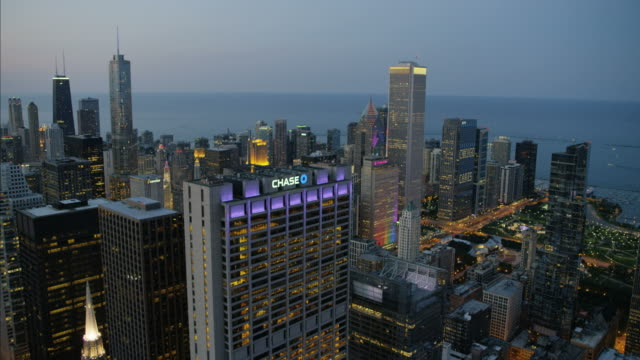 aerial illuminated sunset lake michigan millennium park chicago - willis tower stock videos and b-roll footage
