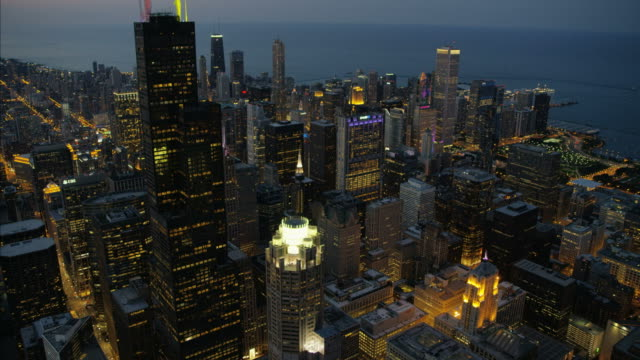 aerial illuminated sunset lake michigan millennium park chicago - sears tower stock-videos und b-roll-filmmaterial