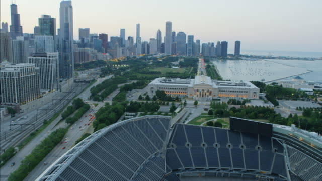 aerial illuminated sunset soldier field football stadium chicago - shedd aquarium stock videos and b-roll footage