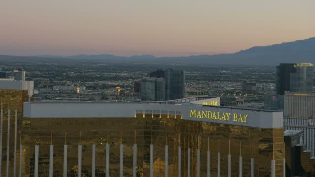 aerial illuminated sunset view mandalay bay las vegas - casino stock videos & royalty-free footage