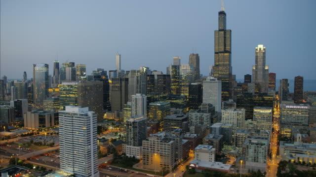 Aerial illuminated sunset view Willis Tower Chicago city