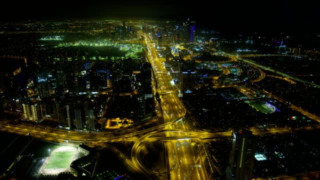 Aerial illuminated view Emirates Hills golf club Dubai