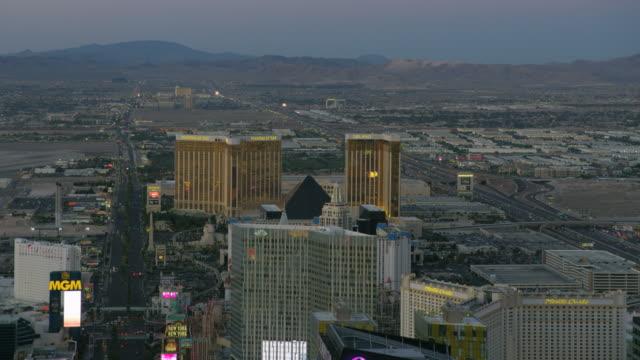 aerial illuminated view las vegas blvd casino hotels - casino stock videos & royalty-free footage