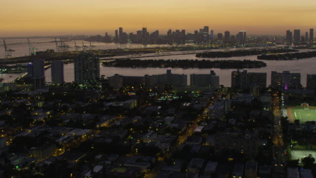 aerial illuminated view north beach star island miami - star island stock videos & royalty-free footage