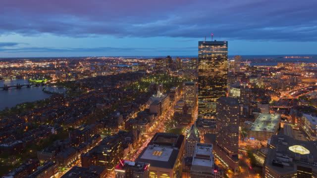 t/l aerial illuminated view of boston skyline at dusk / boston, massachusetts, usa - massachusetts stock videos & royalty-free footage