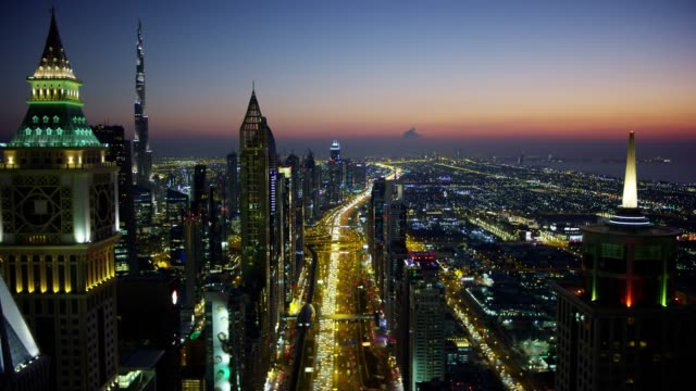 aerial illuminated view sheikh zayed road skyscrapers dubai - skyscraper stock videos & royalty-free footage