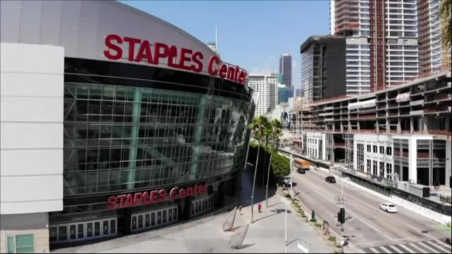 aerial images of the staples center and the lafc stadium in los angeles as the state of california starts easing coronavirus restrictions but says... - staples center video stock e b–roll
