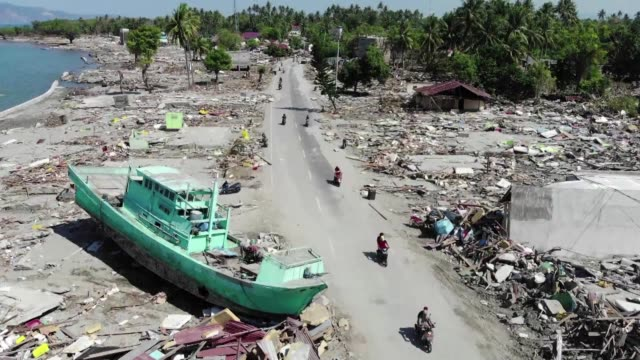 aerial images show extent of the devastation after a tsunami hit the indonesian island of sulawesi - tsunami stock videos & royalty-free footage
