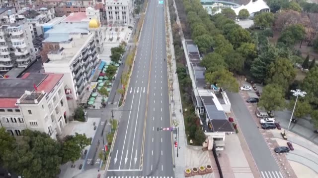 stockvideo's en b-roll-footage met aerial images show how deserted the central chinese city of wuhan has become under lockdown as authorities scramble to stop a deadly coronavirus... - lockdown