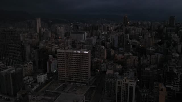 aerial images show lebanon's state-run electricity company sign appearing half-lit up against a dark beirut cityscape as vehicles creep cautiously... - democracy stock videos & royalty-free footage