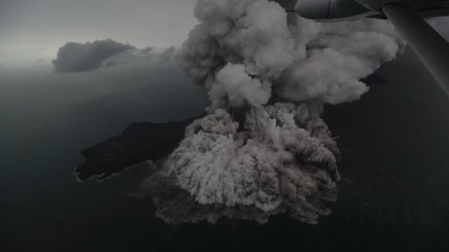 aerial images show the anak krakatoa volcano in indonesia erupting the cause of the powerful tsunami that swept over the popular beaches on southern... - java stock videos & royalty-free footage