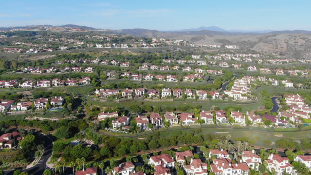 aerial: immaculate huntington beach neighborhood - laguna beach, california - laguna beach california stock videos & royalty-free footage