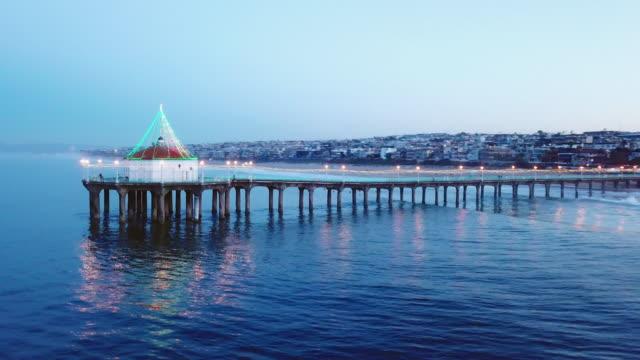 aerial: incredible manhattan beach pier - gazebo stock videos & royalty-free footage