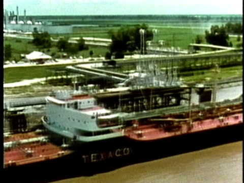 1969 MONTAGE Aerial WS Industrial plants and refineries lining riverbank/ USA/ AUDIO