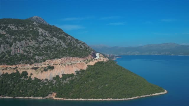 Aerial - Ionian Sea - revealing the town of Astakos by the sea