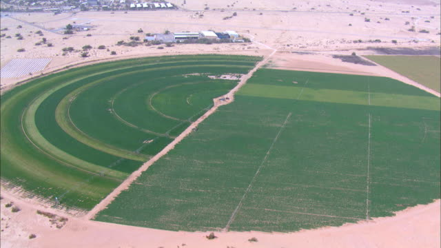 aerial irrigation boom across circular agricultural fields in negev desert, negev, israel - irrigation equipment stock videos & royalty-free footage