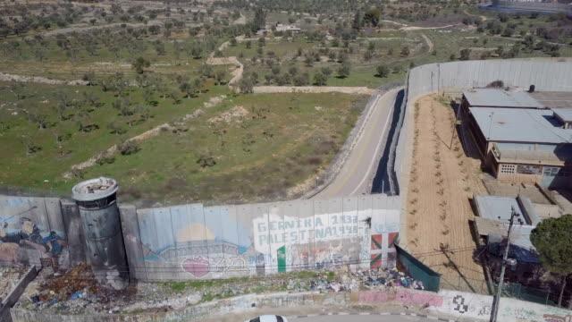 aerial / israeli west bank barrier near beit jala ,beit lehem and rachel's tomb, jerusalem - hebron west bank stock videos & royalty-free footage