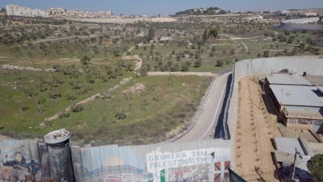 Aerial / Israeli West Bank barrier near Beit Jala ,Beit Lehem and Rachel's Tomb, Jerusalem