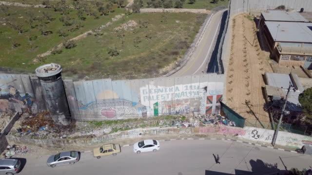 aerial / israeli west bank barrier near beit jala ,beit lehem and rachel's tomb, jerusalem - israel stock videos & royalty-free footage