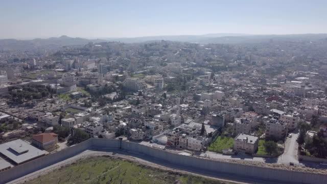 aerial / israeli west bank barrier near beit jala ,beit lehem and rachel's tomb, jerusalem - west bank stock videos & royalty-free footage