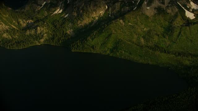 aerial jackson lake at sunrise yellowstone national park - mt moran stock videos & royalty-free footage