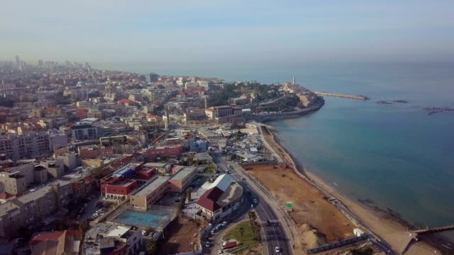 stockvideo's en b-roll-footage met aerial/ jaffa and tel aviv coastline with hotels, beaches, and promenade - jaffa