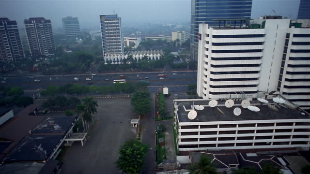 Aerial Jalan Gatot Subroto highway and surrounding area / satellite dishes on building roof / Jakarta