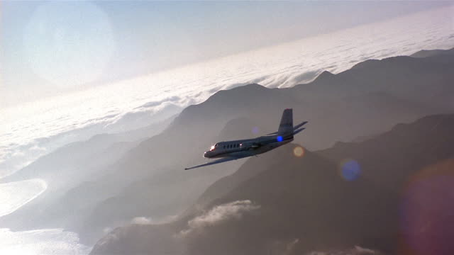 Aerial jet flying over mountains