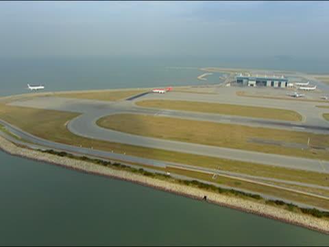 2002 aerial jet landing at hong kong international airport/ hong kong - hong kong international airport stock videos and b-roll footage