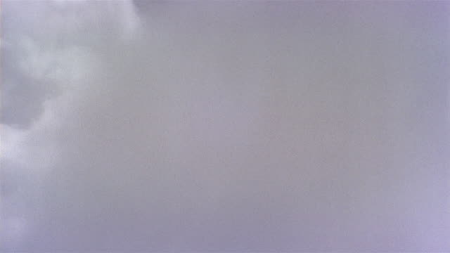 Aerial jet point of view flying through a cloud