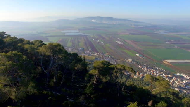Aerial/ Jezreel Valley reveals in background ,Mount Tabor, Galilee