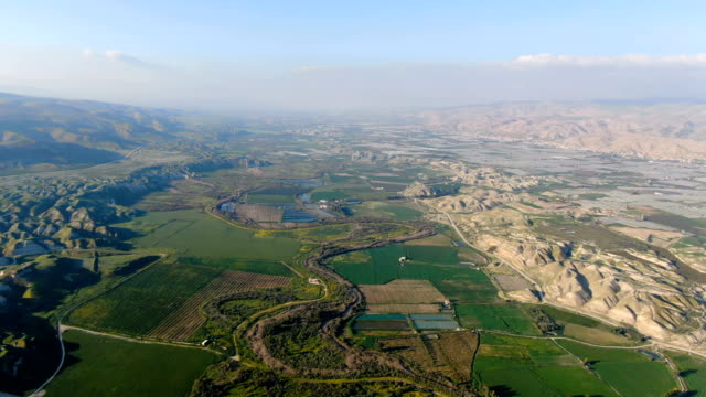 aerial / jordan valley agriculture, with israel left and jordan right - valley stock videos & royalty-free footage