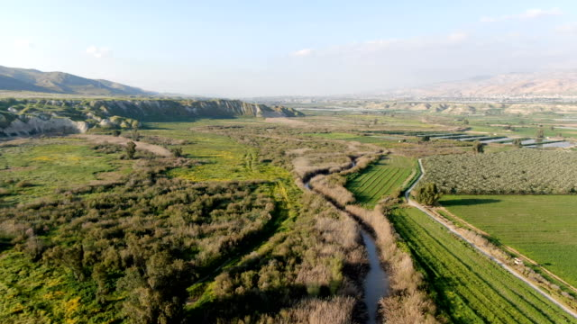 aerial / jordan valley agriculture, with israel left and jordan right - middle east stock videos & royalty-free footage