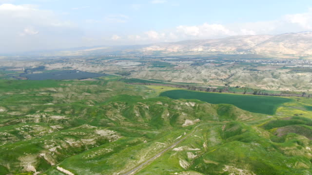 aerial / jordan valley in spring with green pastures - middle east stock videos & royalty-free footage