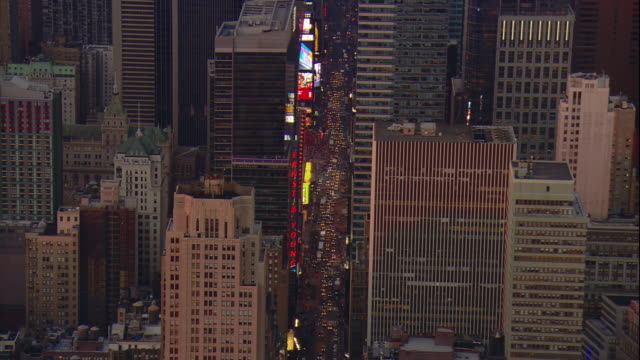 aerial -just after sunset over mid-town manhattan, a zi to traffic on broadway in the times square and theater district areas. - manhattan theater district stock videos and b-roll footage