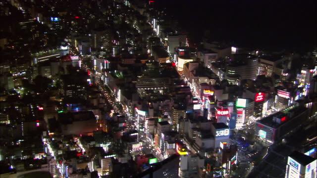 Aerial Kabuki-cho district at night/ pan skyscrapers/ Tokyo / November 16, 2005
