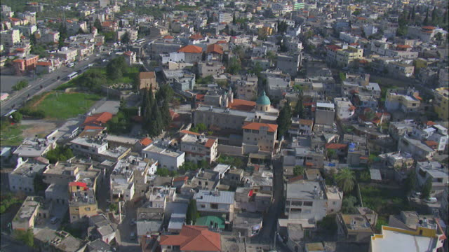 aerial kafr kanna, an arab town associated with the new testament village of cana where jesus turned water into wine, galilee, israel - avvenimento biblico video stock e b–roll
