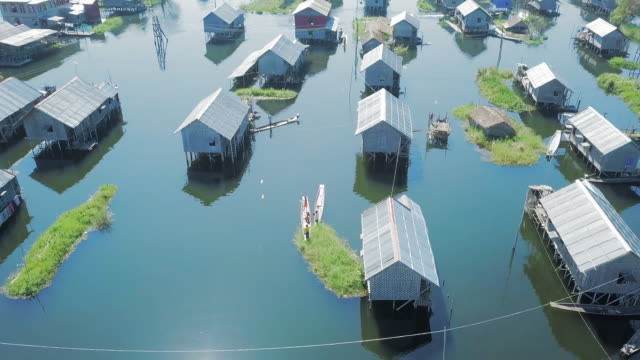 aerial: kids on boats flying kites on inle lake - flood stock videos & royalty-free footage