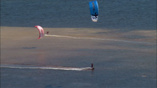 aerial kite surfers jumping in air in biscayne bay / miami, florida - biscayne bay stock-videos und b-roll-filmmaterial