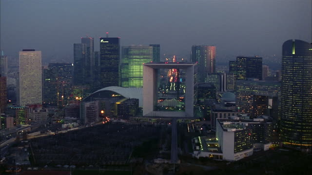 aerial la defense with grande arche in center and view of triumphal way / paris, france - downtown stock videos & royalty-free footage