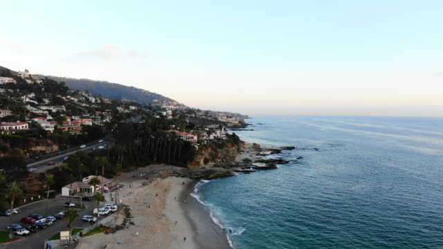 aerial: laguna beach and ocean waves - laguna beach, california - laguna beach california stock videos & royalty-free footage